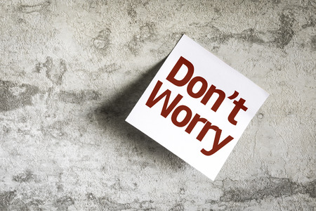 dont worry: Dont Worry written on sticky note on wall