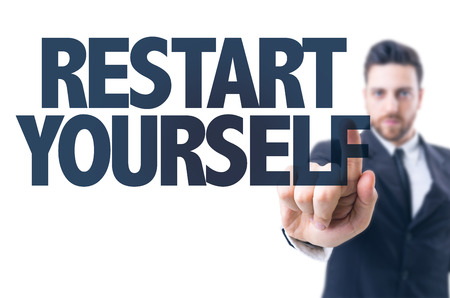 restart: Business man pointing the text: Restart Yourself Stock Photo