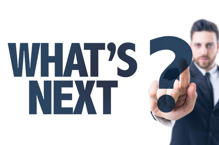 what's ahead: Business man pointing the text: Whats Next?