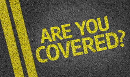 Are You Covered written on asphalt road