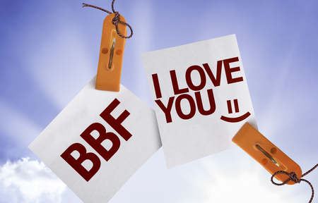 bff: BFF I Love You written on paper note on sky background