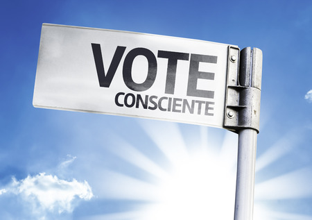 conscientious: Vote conscientiously sign with clouds and sky background