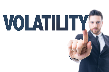 volatility: Business man pointing the text: Volatility