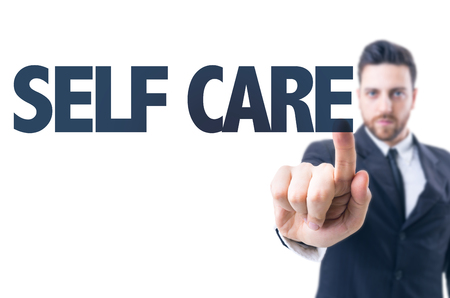 self care: Business man pointing the text: Self Care