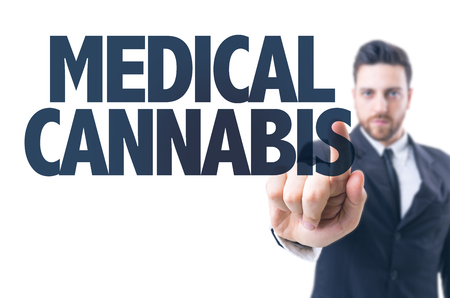 controversial: Business man pointing the text: Medical Cannabis Stock Photo