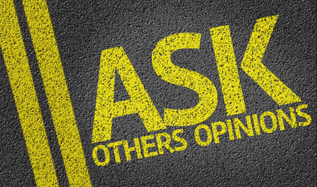 Ask Others Opinions written on the road Stock Photo