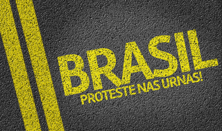nas: Brasil, Proteste nas Urnas written on the road (in portuguese: translate: Brazil, Protest at the ballot box)