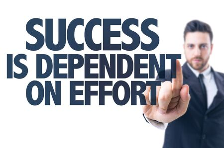 dependent: Business man pointing the text: Success is Dependent on Effort