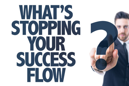stopping: Business man pointing: Whats Stopping Your Success Flow?