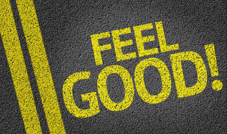 by feel: Feel Good! written on road