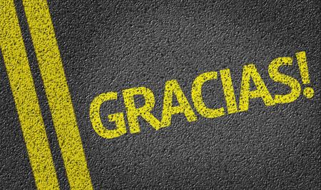 Gracias written on the road (in spanish)