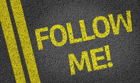 follow: Follow Me! written on road
