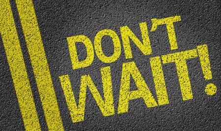 HESITATE: Dont Wait! written on road