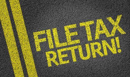 File Tax Return! written on the road Stock Photo