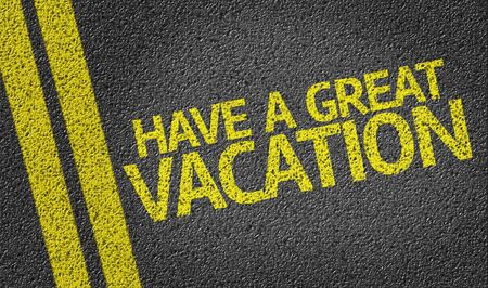 to have: Have A Great Vacation written on road Stock Photo