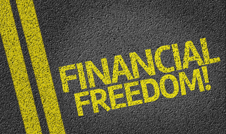 Financial Freedom! written on road Stock Photo