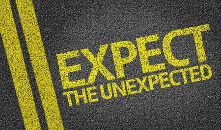 Expect the Unexpected written on the road Stock Photo