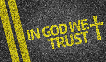 in god we trust: In God We Trust written on road