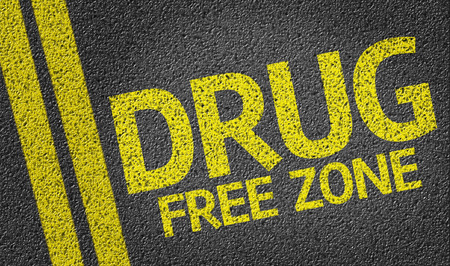 Drug Free Zone written on the road Stock Photo