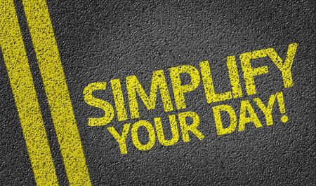 optimum: Simplify Your Day! written on road