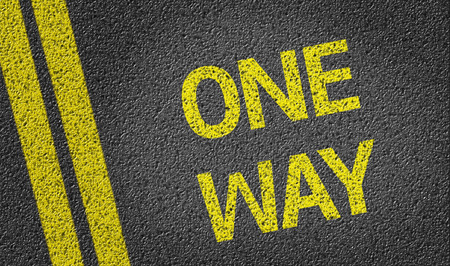 risks ahead: One Way written on the road