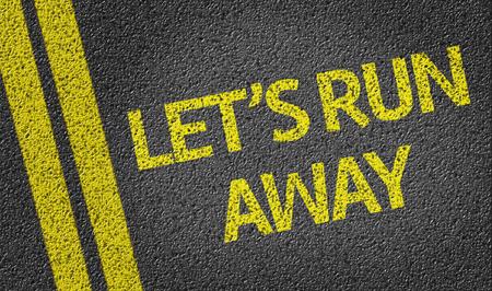 run away: Lets Run Away written on the road Stock Photo
