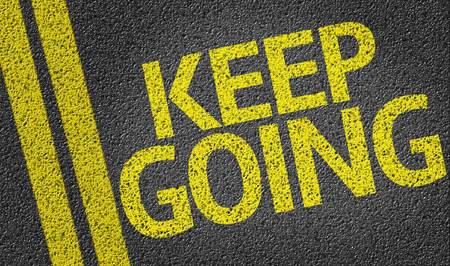 Keep Going written on the road