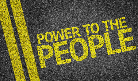 safety slogan: Power To The People written on the road