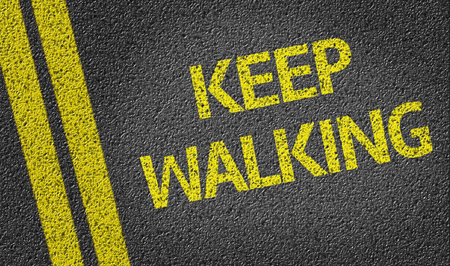 forthcoming: Keep Walking written on asphalt road