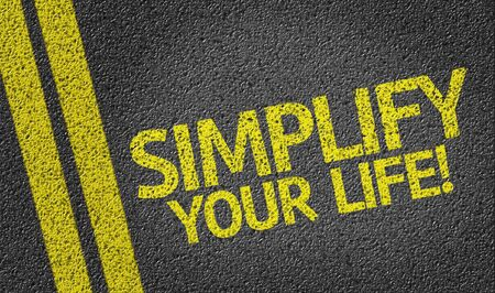Simplify Your Life written on asphalt road Stock Photo