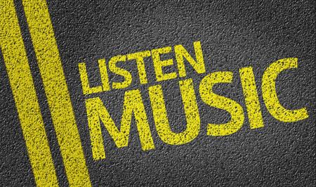 listen music: Listen Music written on asphalt road