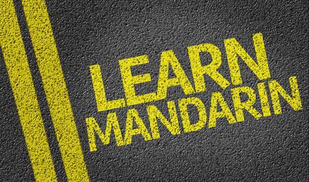 Learn Mandarin written on asphalt road Stock Photo
