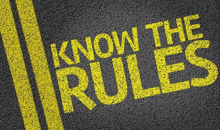 street wise: Know The Rules written on asphalt road