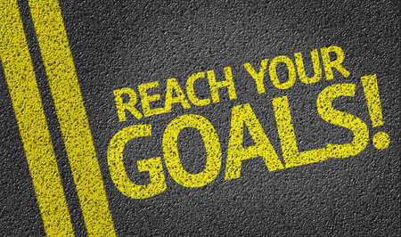 Reach Your Goals written on asphalt road Stock Photo
