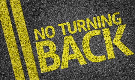 No Turning Back written on asphalt road