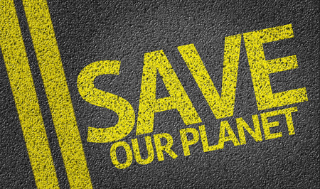 our: Save Our Planet written on asphalt road