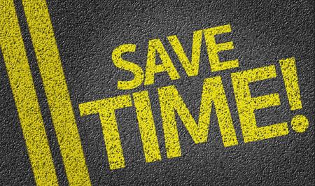 save time: Save Time written on asphalt road