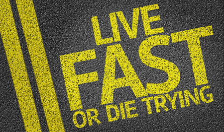 Live Fast or Die Trying on asphalt road