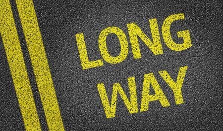 long way: Long Way written on asphalt road
