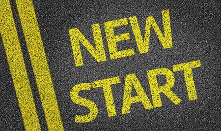 new start: New Start written on asphalt road