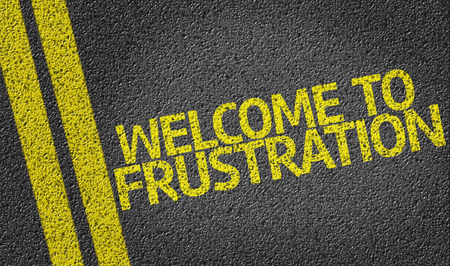 Welcome To Frustration written on asphalt road