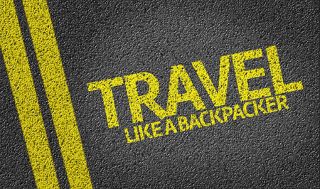 Travel Like A Backpacker written on asphalt road