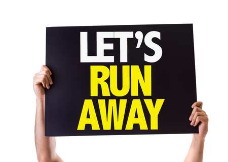 run away: Hands holding blackboard with Lets Run Away on white background Stock Photo