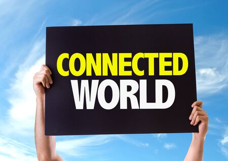 connected world: Hands holding card with Connected World on sky background