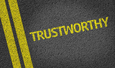 trustworthy: Trustworthy written on asphalt road Stock Photo