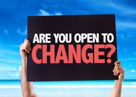 alteration: Hands holding blackboard with Are You Open To Change on beach background