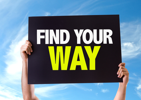 find your way: Hands holding blackboard with Find Your Way on sky background Stock Photo