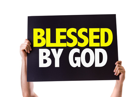 Hands holding blackboard with Blessed By God on white background