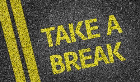 take a break: Take a Break on tar road Stock Photo