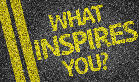 what: What Inspires You on tar road Stock Photo